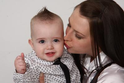 A kiss from mommy and thumbs up!