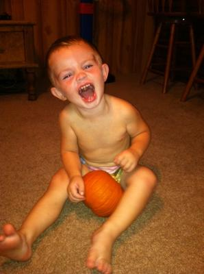 Chase decorating his first pumpkin...