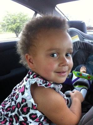 Buckling her Buzz Lightyear into her carseat!
