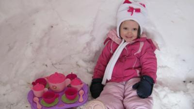 Ainsley had a tea party in an igloo in our front yard.