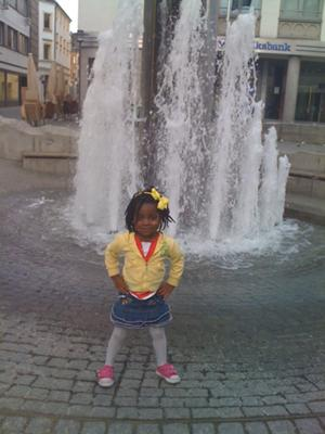 Zuri in Weiden Germany splashing in the fountain